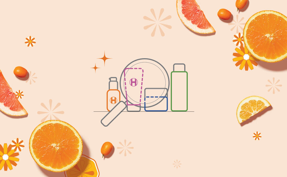 Skincare emoticons and a magnifying glass on a background with oranges and grapefruits surrounding it.